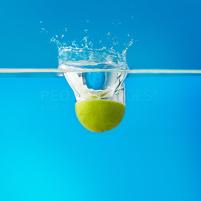 Buy stock photo Half lime immersed in water against background