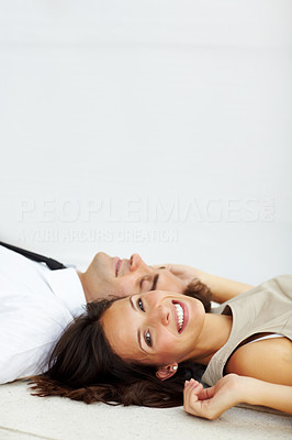 Buy stock photo Portrait of beautiful young woman lying on floor with her boyfriend smiling - Copyspace