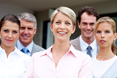 Buy stock photo Young business woman smiling with her colleagues in background
