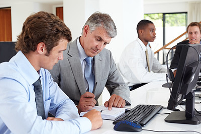 Buy stock photo Team of business men working together on a new project in the office