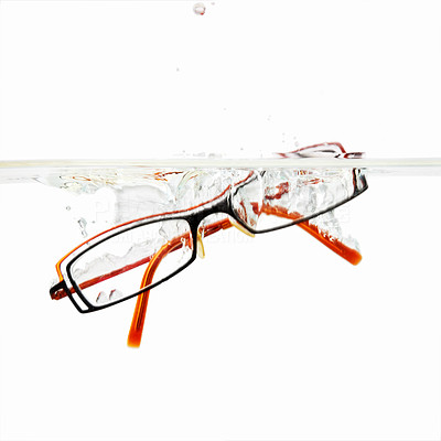 Buy stock photo Pair of glasses dropped into water against white background