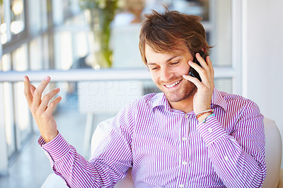 Buy stock photo Smart young business man having conversation on cell phone
