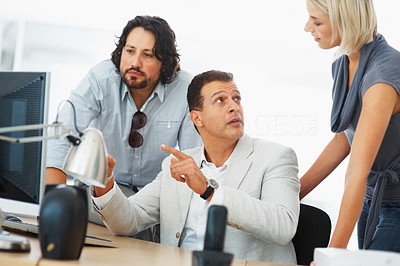 Buy stock photo Leader discussing project with his team at office