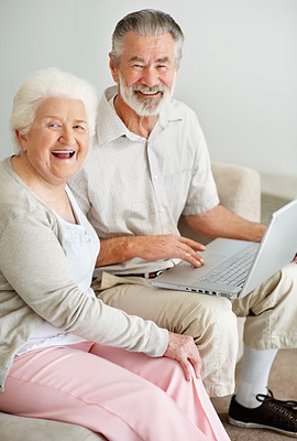 Buy stock photo Portrait of a happy senior couple using a laptop and smiling at the camera
