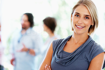 Buy stock photo Young business woman with people discussing in background