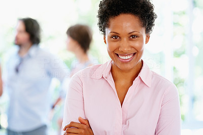 Buy stock photo Woman standing with arms folded and group in background