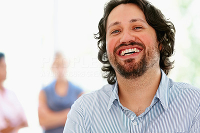 Buy stock photo Focus on happy man with people in background