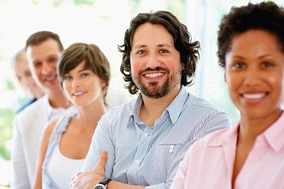 Buy stock photo View of team in row with focus on man
