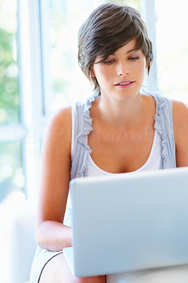 Buy stock photo View of attractive woman working on laptop