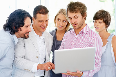 Buy stock photo Man showing group of people something on laptop