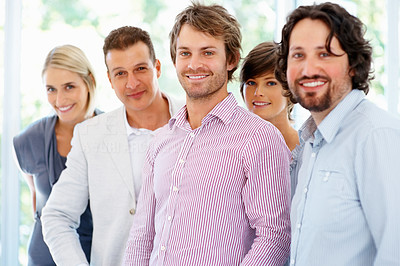 Buy stock photo Portrait of young business people standing together