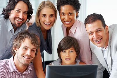 Buy stock photo Successful professionals smiling together in front of computer