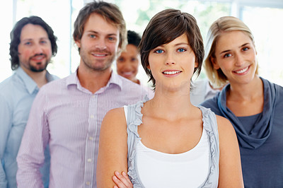 Buy stock photo Attractive and ambitious business woman with her team in background