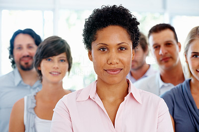 Buy stock photo Closeup of African American business woman with team in background