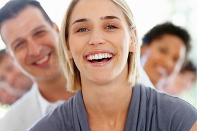 Buy stock photo Successful young business woman with friendly team in background