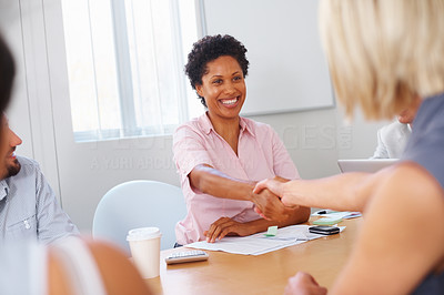 Buy stock photo Two business woman shaking hands in meeting room