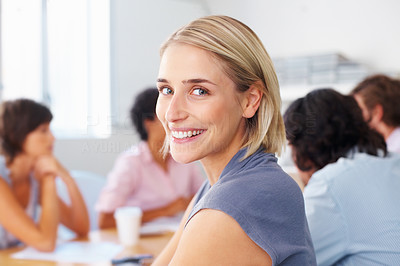 Buy stock photo Happy woman smiling with team discussing in meeting