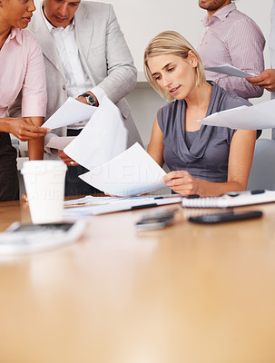 Buy stock photo Business people working with documents at meeting