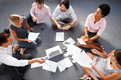 Buy stock photo Top view of business people sitting in circle and discussing project