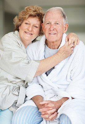 Buy stock photo Portrait of an affectionate senior woman embracing her husband at home