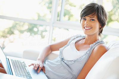 Buy stock photo Pretty young woman smiling with laptop