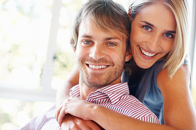 Buy stock photo Portrait of happy woman embracing her man from behind
