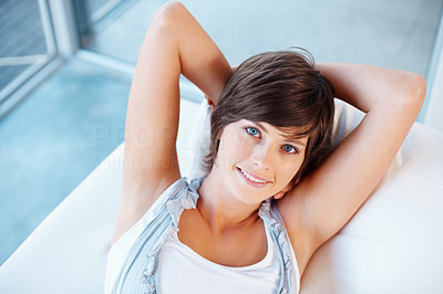 Buy stock photo Closeup of attractive young woman lying on sofa