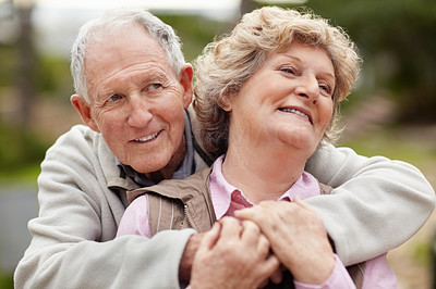 Buy stock photo Portrait of a romantic mature man embracing senior woman
