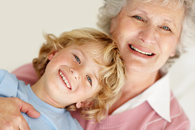 Buy stock photo Closeup portrait of a happy grandson with his caring grandmother