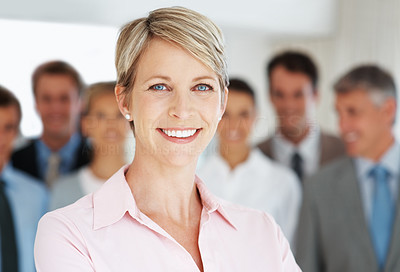 Buy stock photo Smart young businesswoman and her successful team at the backSmart young businesswoman smiling with her successful team at the back