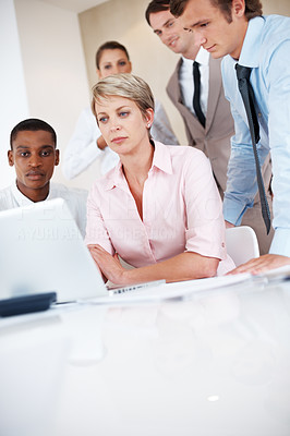 Buy stock photo Portrait of a female senior manager working on laptop with her colleagues at office - Teamwork