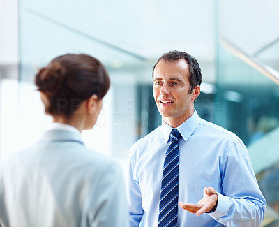 An office executive having a conversation with his team leader