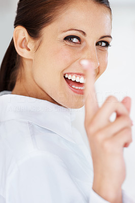 Buy stock photo Portrait of a cheerful young business woman pointing up