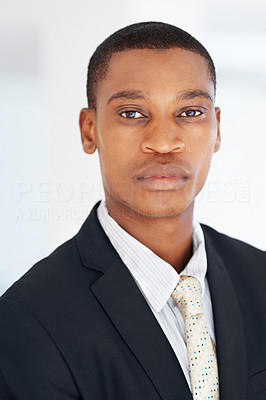Buy stock photo Closeup portrait of an african american businessman looking confidently at office