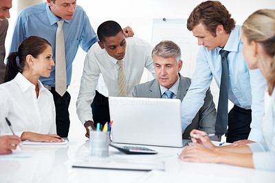 Buy stock photo Portrait of a multi ethnic business team working together on laptop at meeting