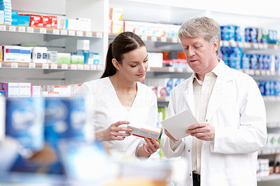Pharmacists checking the medicine from the prescription