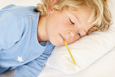 Buy stock photo Portrait of a sick boy lying on bed with thermometer in his mouth