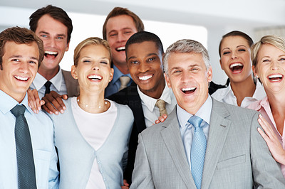 Buy stock photo Group of a successful business people standing together at office and smiling at the camera excitedly