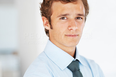 Buy stock photo Portrait of a confident young male business executive looking with attitude