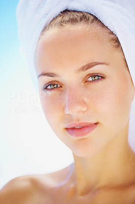 Closeup of a young woman with a towel wrapped on her head
