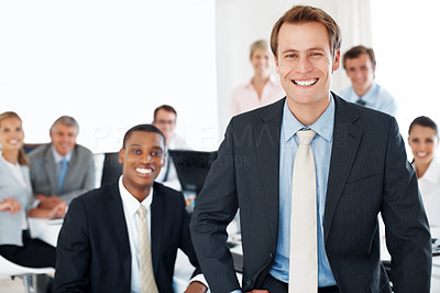 Buy stock photo Happy group of businesspeople smiling and taking break from work at office