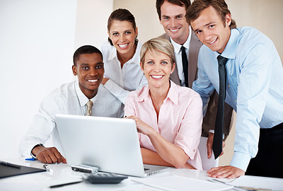 Buy stock photo Happy group of businesspeople with a laptop in board room