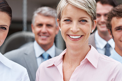 Buy stock photo Portrait of a confident business woman with her supporting team in background