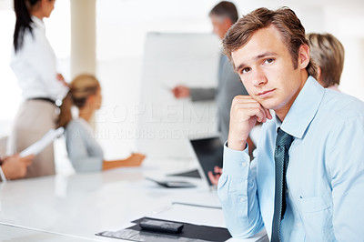 Buy stock photo Portrait of a confident young businessman attending a presentation at office