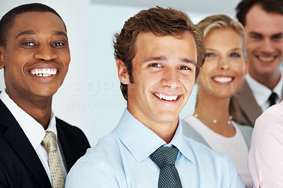 Buy stock photo Multiracial business colleagues standing together and smiling at office