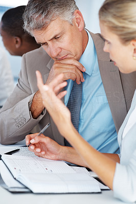 Buy stock photo Portrait of a confident senior manager planning work with his colleagues in a meeting