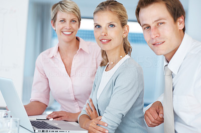 Buy stock photo Group of businesspeople taking a break while working on project at office