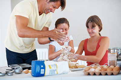 Buy stock photo Young girls kneading dough with father adding flour