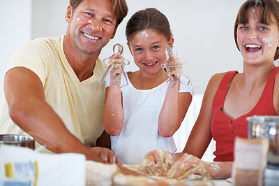 Buy stock photo Portrait of family preparing cookies in the kitchen, having fun and making a mess