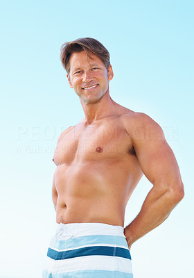 Buy stock photo Portrait of healthy man standing against sky and smiling